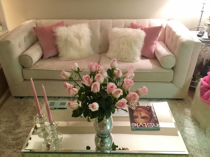 Spring colors - pink living room with mirrored coffee table and shaggy cushions.