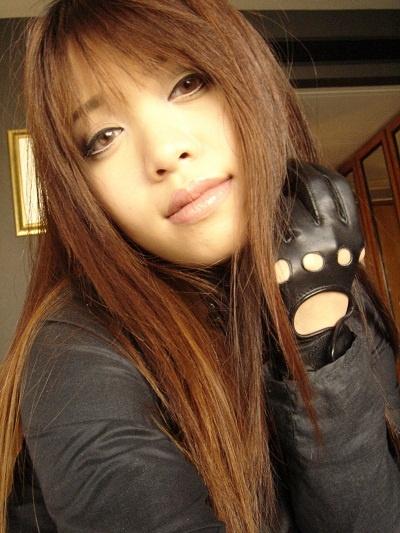 Michelle Phan, long brown hair with blunt bangs