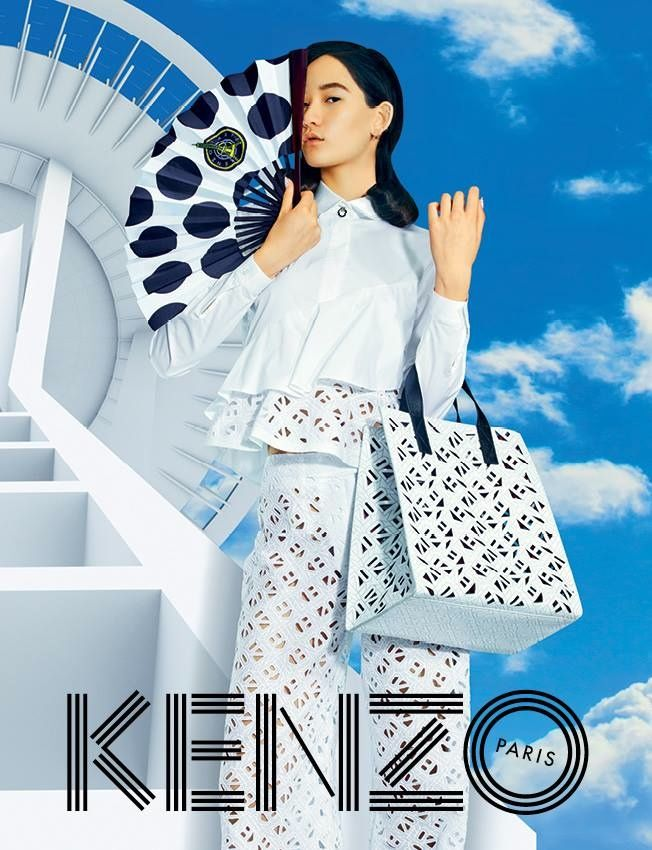 Keeping in their tradition of off-kilter and often whimsical campaigns, Kenzo creative directors Humberto Leon & Carol Lim collaborated with TOILETPAPER for the fourth time on the brand's spring-summer 2015 advertisements. The images feature models Mona Matsuoka and Zhao Qinghe posing against a backdrop featuring a futuristic city with a cloud-filled landscape. Front and center are the colorful, pattern-filled new season designs.