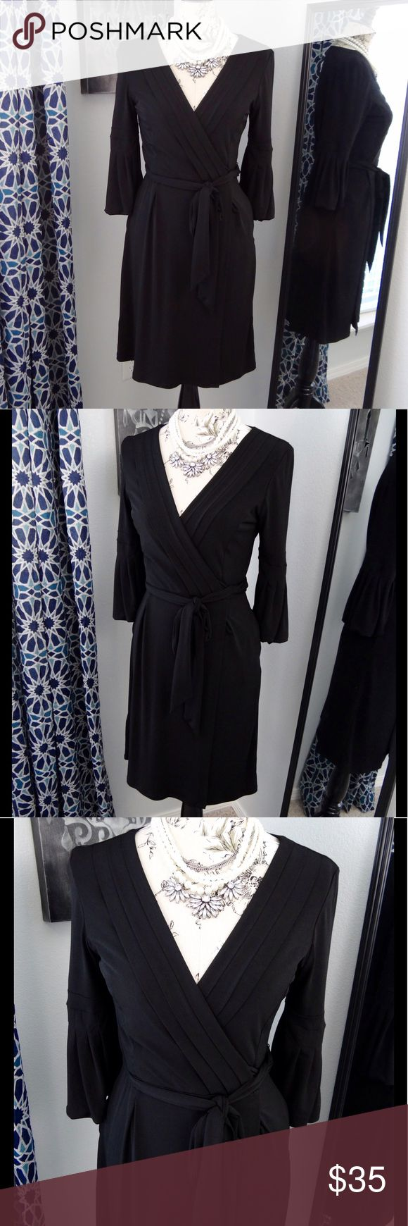 Max and Cleo black wrap dress with pockets Max and Cleo black wrap dress. Like new, clean condition. No holes or stains, no pilling, no fade. Great condition! Strong black color. Size small, the bust measures at 17 inches across. The length is 38 inches. The dress has pockets! Smoke free and pet free home! Max and Cleo Dresses Midi