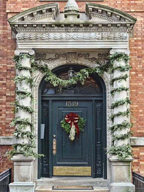 Holiday decorations at the entrance to a building on North State Parkway in the Gold Coast area of Chicago, Illinois.