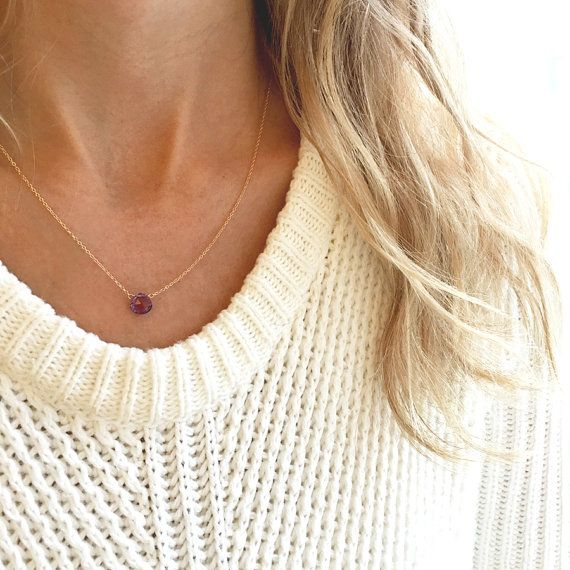 This amethyst necklace has an amethyst that sits on a dainty 14k gold filled/sterling silver/rose gold filled or 14k gold chain and lays below the collarbone. Subtle and simple, this beautiful semi-precious stone necklace is perfect by itself or layered with another necklace. Amethyst