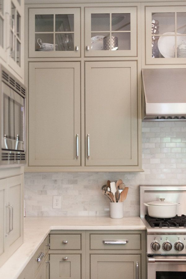 Greige kitchen cabinets with tile backsplash. Classic and neutral. This is a kitchen you would never tire of.