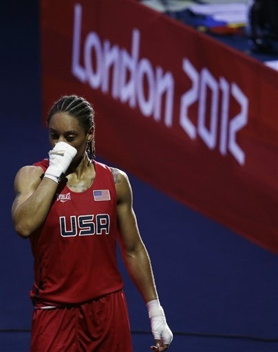 Quanitta Underwood of the United States, leaves the arena after her fight against Natasha Jonas of Great Britain, during the women's lightweight boxing competition at the 2012 Summer Olympics, Sunday, Aug. 5, 2012, in London
