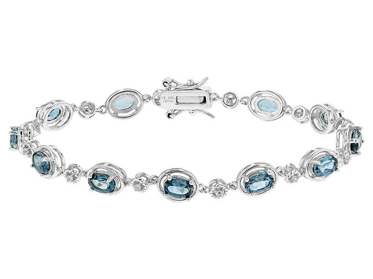 6.57ctw Oval London Blue Topaz And .20ctw Round White Zircon Sterling Silver Bracelet