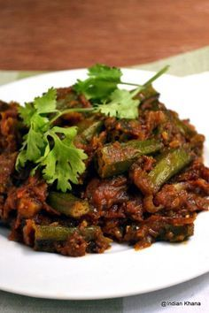 Punjabi Bhindi Masala Okra: 2 cups okra, 1 tomato, 1 onion,1 garlic, 1 T. cilantro, 1 t. cumin, 1 t. ginger, 1 t. coriander, 1/4 t. turmeric, salt, optional some kind of masala slice blend