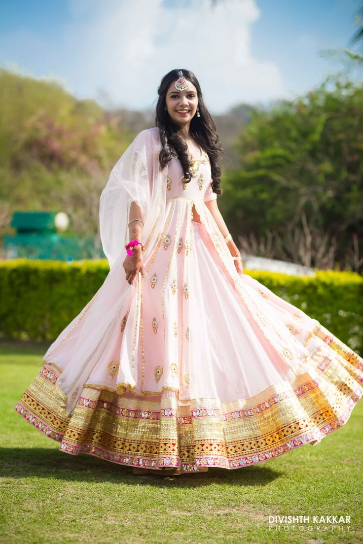 Twirling Lehengas - Pastel Pink Twirling Lehenga | WedMeGood | Pastel Pink Lehenga with Gold and Neon Green Border and Gold Scattered Motifs #wedmegood #twirling #lehengas