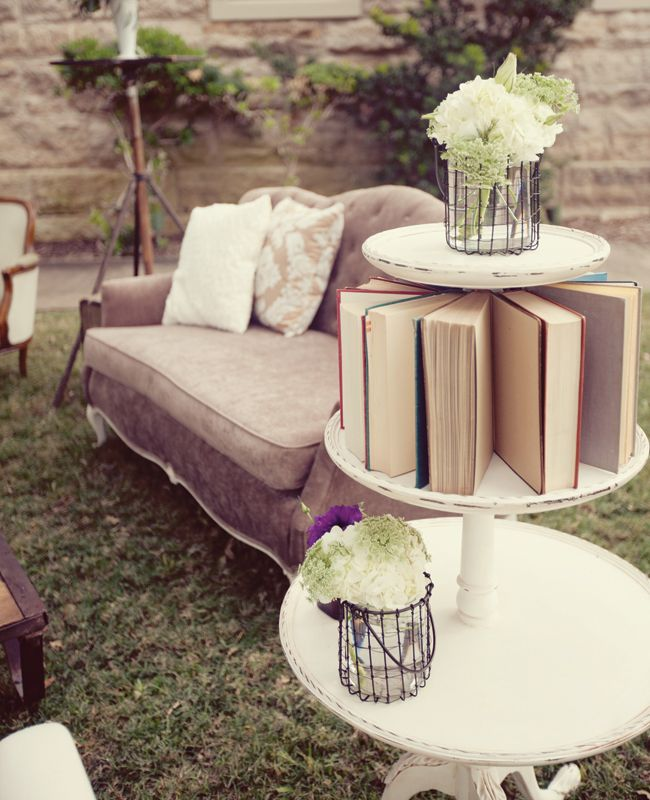 Vintage-y lounge area. I love the idea of an area set off with couches for when people get tired of dancing :)