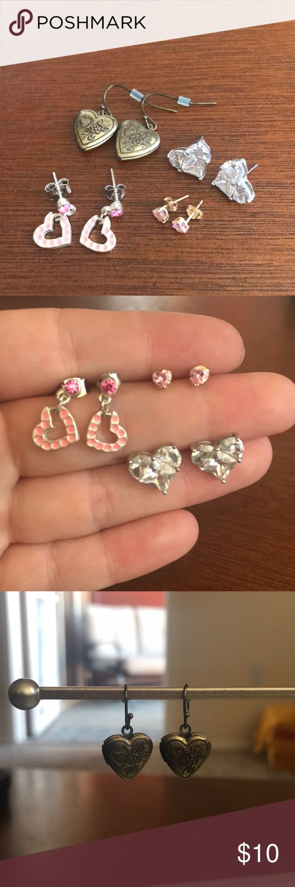 4 pairs of heart shaped earrings 4 pairs of adorable heart shaped earrings. 1. Small pink heart studs. 2. Large sparkle studs. 3. Pink studs with dangle hearts. 4. Detailed heart locket dangle earrings. Jewelry Earrings