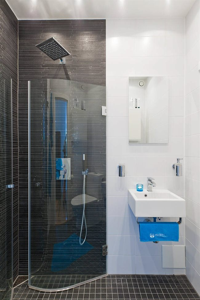 small shower. big style. saves space by folding in when not in use.