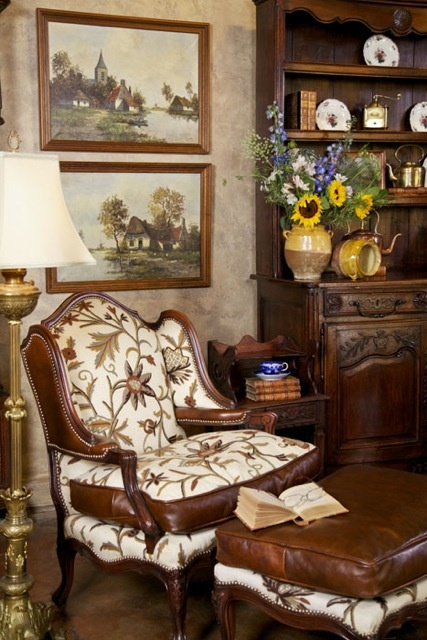 Country French Decorating with Antiques ~ A cozy reading area complete with fresh flowers and lovely paintings. #antique #decorating