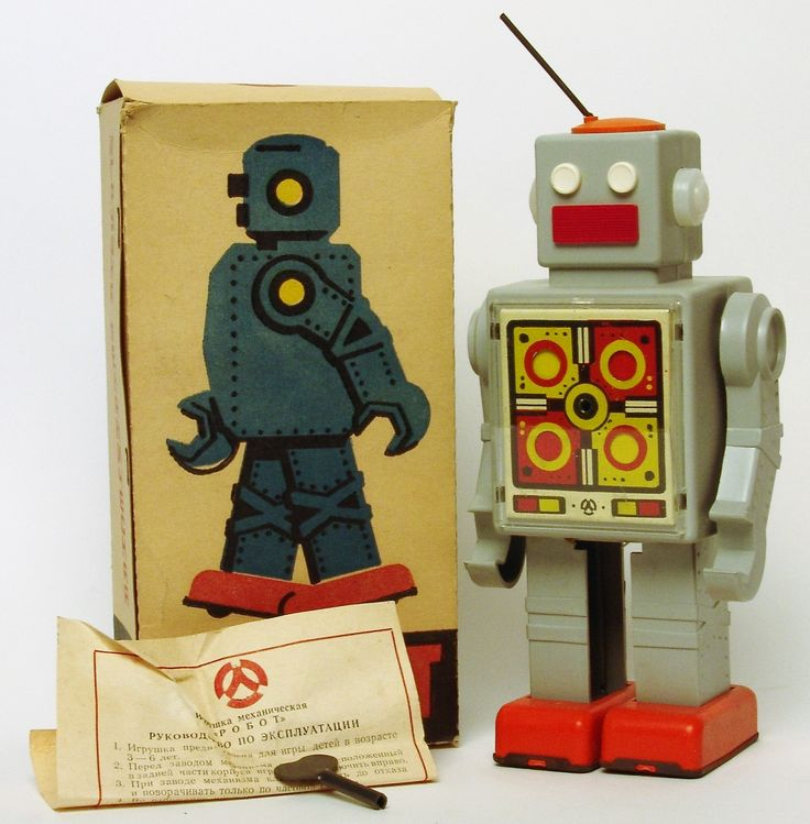 Back in the USSR, these cool robots were produced with walking action as the chest mounted color wheel rotates. This one is complete with the original key, box insert, and pamphlet. The box is in good