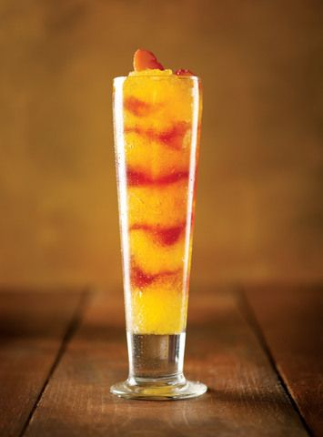 Macaroni Grill's Frozen Peach Bellini: 4 1/2 gal. peach nectar, 1 gal. white wine, 1 750 ml bottle of white rum, 1 750 ml bottle peach schnapps, and 3 750 ml bottles of champagne Combine in a blender with ice, and swirl with Razzmatazz liqueur (Generic Chambord - black raspberry) Adjust home version accordingly.