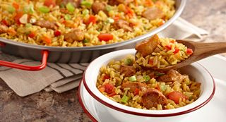 Andouille sausage adds spicy heat to dirty rice. Make it really traditional by adding chicken or duck livers as well.