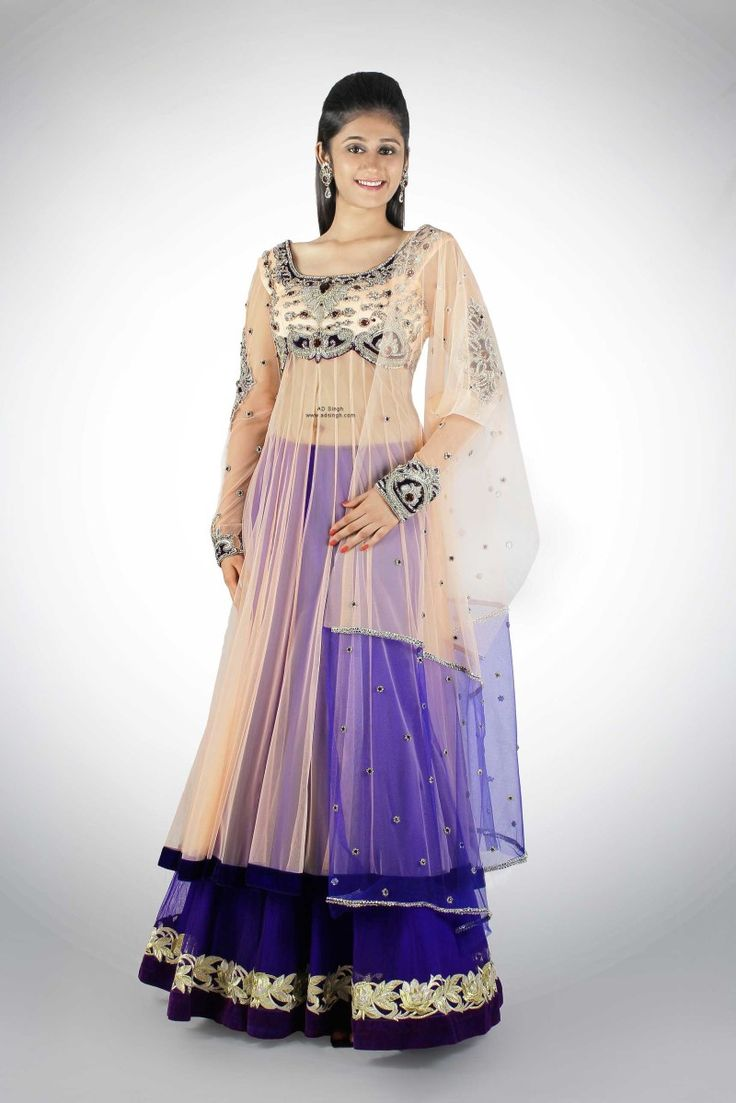 Long Pink & Violet Anarkali with Skirt under made in soft pink and contrast purple color palette. The skirt is made in purple soft tulle nett with an embroidered lace border at the hem. The anarkali has a sheer look with long ready fit sleeves and deep round back and detailed embroidered bodice in Swarovski elements over a fused velvet. The outfit comes with a matching dupatta.  Buy online:  http://www.adsingh.com/product/pink-violet-anarkali-skirt/