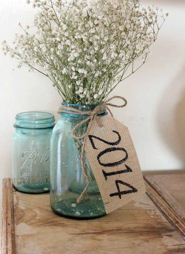 Rustic Burlap Table Tag. Put a bundle of flowers in the mason jar vase, tie rustic burlap tag around the neck of it to create the barn graduation party decor with a fresh flavor.