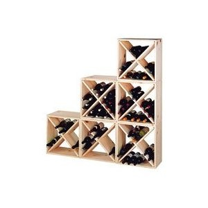 I will probably end up going with white Expedit cube shelving from IKEA to organize the yarn and fabric, but I have always liked the idea of using wooden wine cubes for yarn storage.