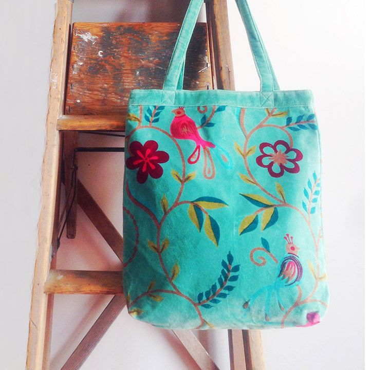 A gorgeous pale aqua velvet tote bag, screen printed with tropical flowers and songbirds in shades of pink and aqua. www.rosaliving.co.nz www.rosaliving.com.au