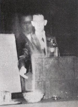 This photo was taken on November 16, 1968 when Robert A. Ferguson, author of Psychic Telemetry: New Key to Health, Wealth, and Perfect Living , was giving a speech at a Spiritualist convention in Los Angeles, California. Faintly appearing next to Ferguson is a figure that he later identified as his brother, Walter, who died in 1944 during World War II.