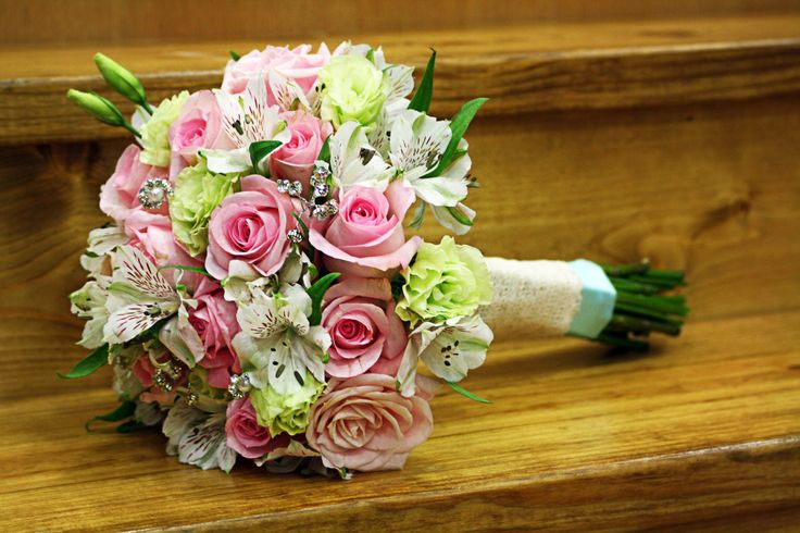 My wedding bouquet!  Bright pink roses, dusty pink roses, white alstroemerias, green lisianthus, and a few jewels and pearls. <3 #wedding