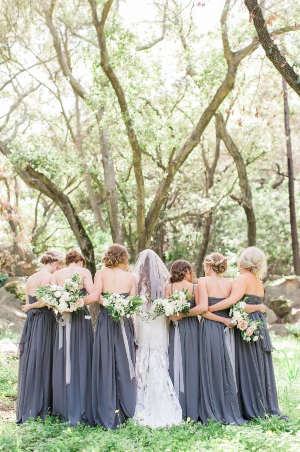 Charcoal gray bridesmaid dresses: http://www.stylemepretty.com/2016/05/17/muted-earth-tones-inspired-wedding-design/ | Photography: Elate Photo - http://www.elatephoto.com/