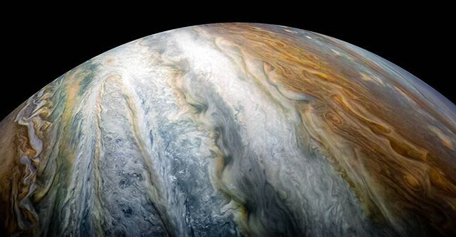 nasa —  The rich, colorful tapestry of Jupiter's southern hemisphere abound with vibrant cloud bands and storms was beheld by our Juno (@NasaJuno) spacecraft from 8,453 miles above during its tenth close flyby of the giant planet on Dec. 16, 2017. The dark region in the far left is called the South Temperate Belt. Intersecting the belt is a ghost-like feature of slithering white clouds, the largest feature in Jupiter's low latitudes.  Citizen scientist Kevin M. Gill processed this image…