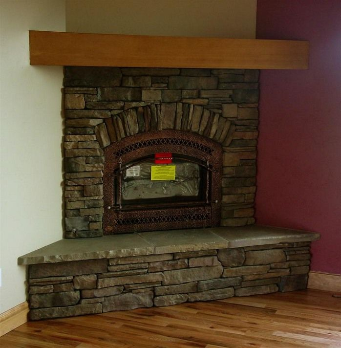 Simple design stone tile corner fireplace with inserts, like flat stone for  the seating