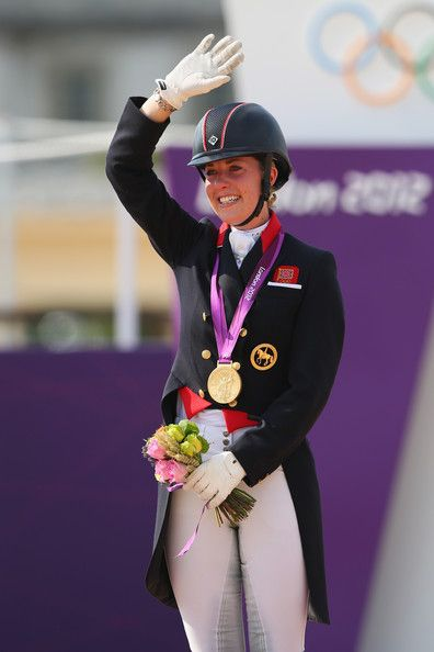 Charlotte Dujardin Photos Photos - Charlotte Dujardin of Great Britain riding Valegro celebrates with her gold medal during the medal ceremony following the Individual Dressage on Day 13 of the London 2012 Olympic Games at Greenwich Park on August 9, 2012 in London, England. - Olympics Day 13 - Equestrian