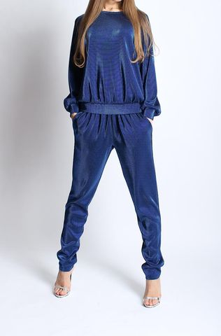Luxurious blue urban chic suit. Consists of the long-sleeve top and trousers. Dress it up with heels and delicate jewellery.