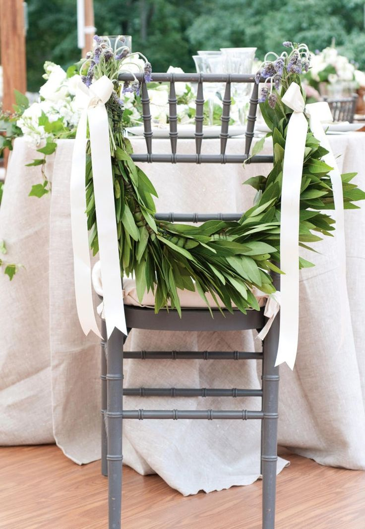 Why not dress up your chairs too?! Add leafy garlands and a few pretty blooms for a classically elegant look.