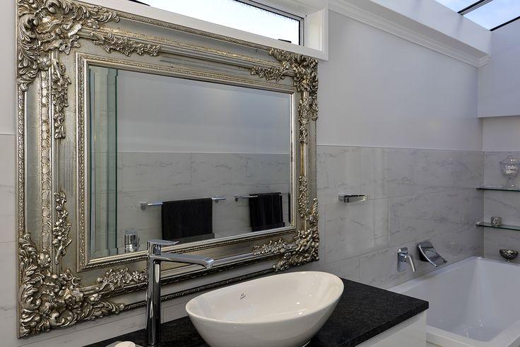 ornate mirror with custom vanity