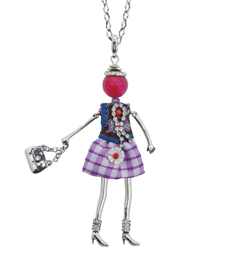 Spencer and Rutherford - Accessories - Long Pendant Necklace - Azura Doll - DecadentEye-catching, individual and gorgeous, this doll necklace emits a personality all of her own. Individually dressed in a tiny, sparkly outfit with coordinated shoes and her very own handbag.  Wear with fun and flair!