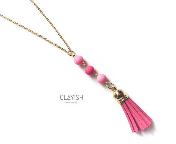 This beautifully match of polymer clay beads and tassel necklace will definitely make your outfit stand out! Currently available in pink colour, however custom order is welcome too! Beads Materials: Polymer Clay Bead Colour: Pink Chain Materials: Copper Chain Colour: Gold/SIlver Length: 52.5 cm Every piece of the clay is carefully shaped and completed by hand, therefore each of them is unique and there might be little imperfections or occasional fingerprints.