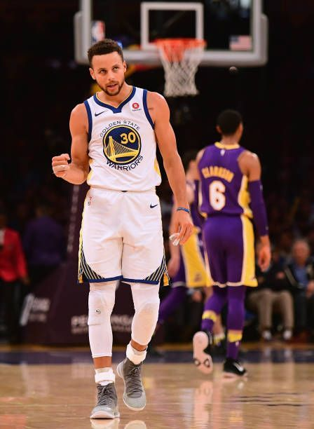 Stephen Curry of the Golden State Warriors celebrates his assist leading to a Klay Thompson three pointer during a 127123 win over the Los Angeles... #NFLFootballBoys