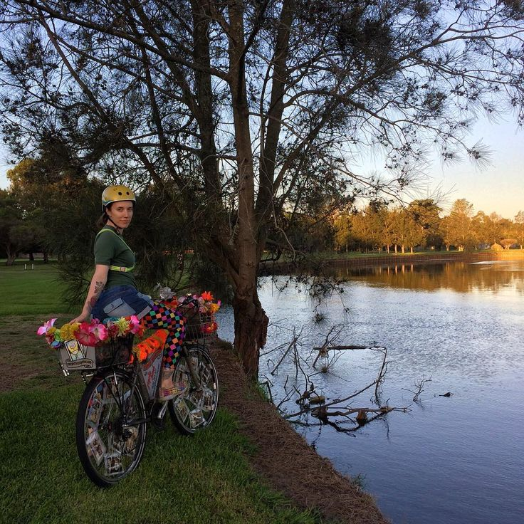 Psychic Sarah and the flowery tarot bike by the River Goolay'yari (Cooks River) in the Inner West of Sydney.