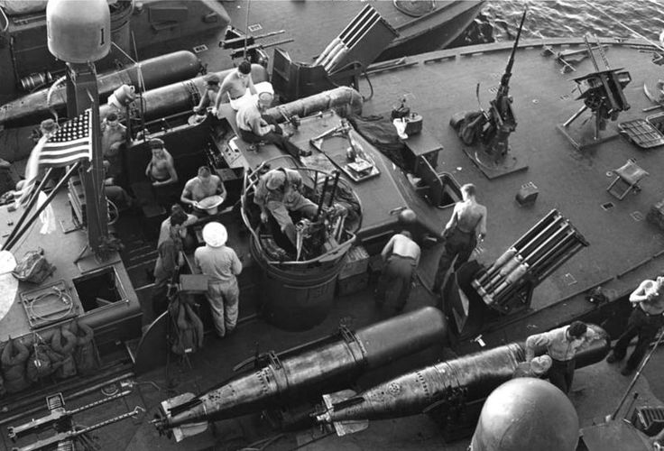 The U.S. Navy motor torpedo boat PT-131 (foreground) and other ELCO type PT boats preparing for the Battle of Surigao Strait, about 24 October 1944. Note the Mark XIII torpedos, rockets, mortar (atop PT-131's forward deckhouse), 20 mm machine cannon and 12.7 mm caliber machine guns carried by these PT boats. Date circa 24 October 1944