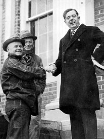 Huey Long shakes hands with constituents on the courthouse steps