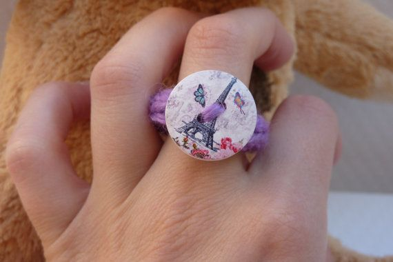Purple ring with a drawing of the Eiffel Tower in Paris, France