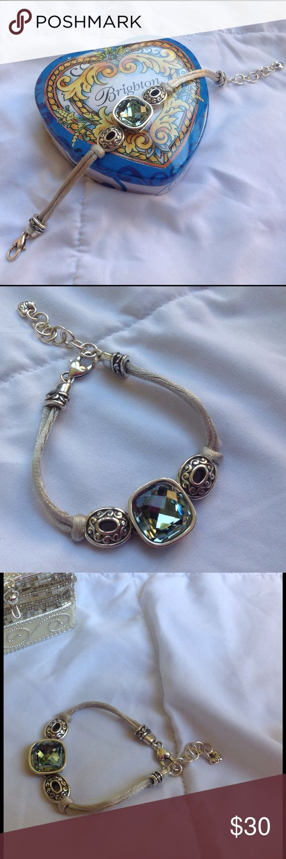 🌟RETIRED Brighton Corded Swarovski Bracelet 🌟 A Retired Venus Design, 7 inches of doubled lite gray soft satin cords showing off this magnificent Swarovski Crystal. This Brighton design Bracelet showcases the Crystal which is centered & glows a mirrored effect of color. Encased in silver & silver hardware as well. Add. Chain for added length. This Retired design is in Perfect Condition. Pic.#4 shown w/matching necklace if you're interested in the set. Ask any ?'s No tarnishing or flaws…