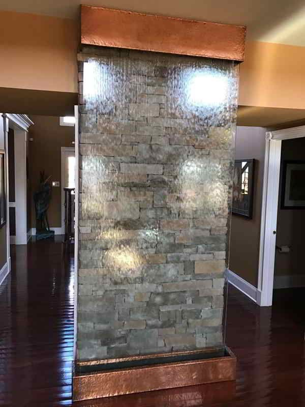 Residential Stone Wall Behind Glass Water Wall For An Indoor Waterfall Waterfall Wall Water