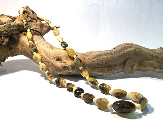 Baltic amber neckleace made of olive shaped beads, multiple colours