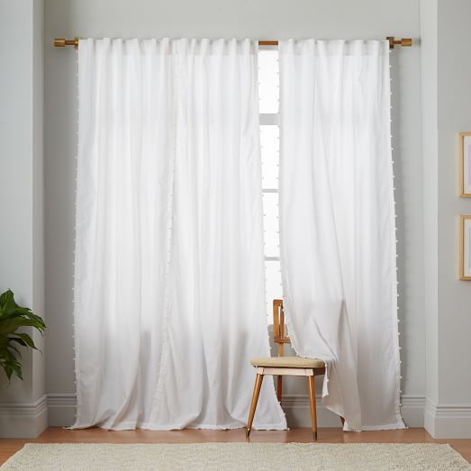 DIY idea - add pompoms to a plain white curtain to imitate these adorable west elm drapes
