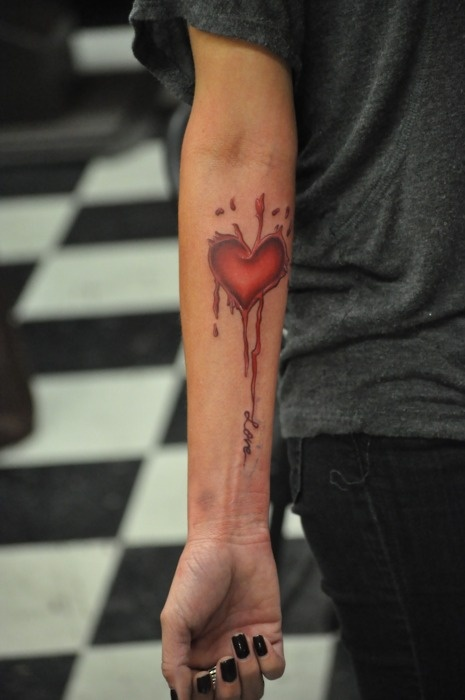 Nice heart tattoo. Beginnings of an awesome sleeve.