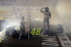 Jimmie Johnson Photos Photos - Jimmie Johnson, driver of the #48 Lowe's Chevrolet, celebrates after winning the NASCAR Sprint Cup Series Ford EcoBoost 400 and the 2016 NASCAR Sprint Cup Series Championship at Homestead-Miami Speedway on November 20, 2016 in Homestead, Florida. Johnson wins a record-tying 7th NASCAR title. - NASCAR Sprint Cup Series Ford EcoBoost 400
