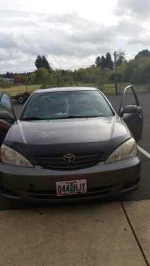 Toyota camry 2003 in Salem, OR (sells for $2,900)