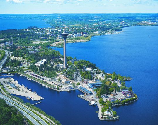 Tampere: a city between two lakes. Näsinneula tower and amusement park b.y the lake.