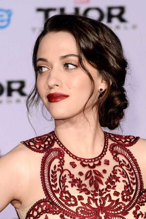 Kat Dennings with her typical dark lipstick and coordinating crimsom dress.