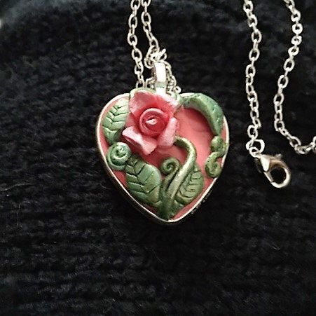 A personal favorite from my Etsy shop https://www.etsy.com/listing/500562119/rose-heart-pendant-necklace
