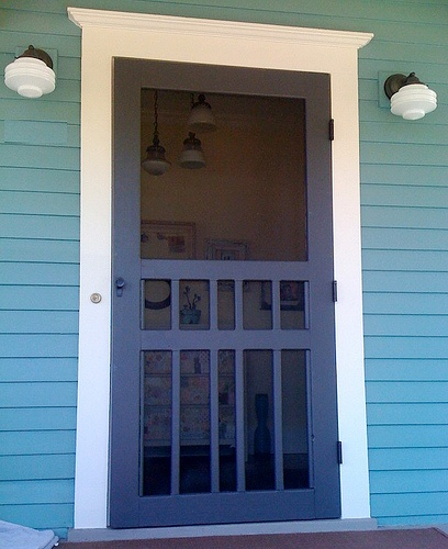 Love this screen door and the milk glass sconces