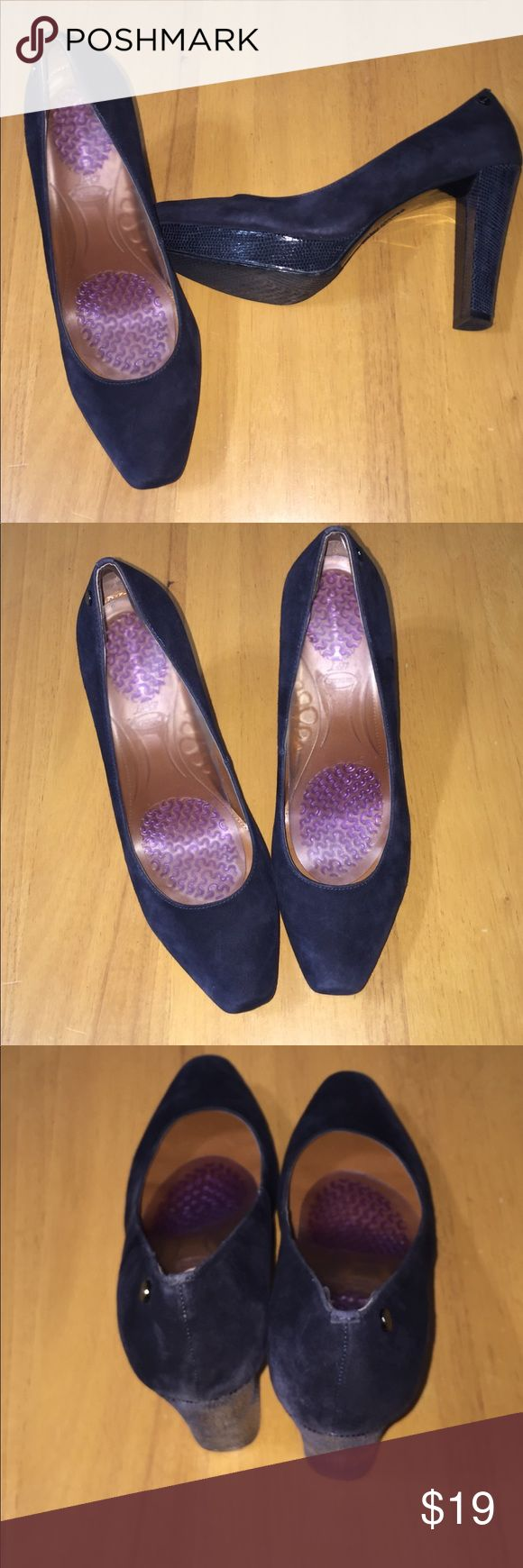 Calvin Klein navy 4 1/4 inch heels 4 inch navy suede heels with 1 inch front platform. Snake skin print heel Size 9m. Very comfortable. Good condition. CK symbol embossed on back of shoe. Calvin Klein Shoes Heels